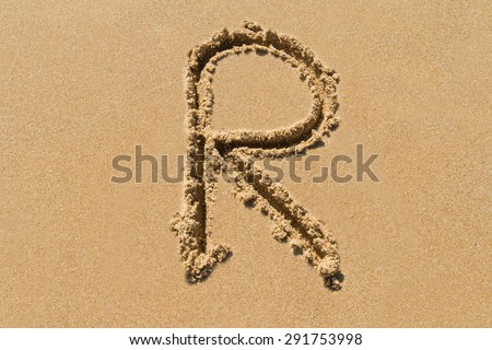 Letter R of the alphabet written on sand with upper case. - stock photo
