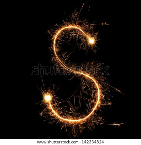 "Letter ""S"" sparklers on black background - stock photo"