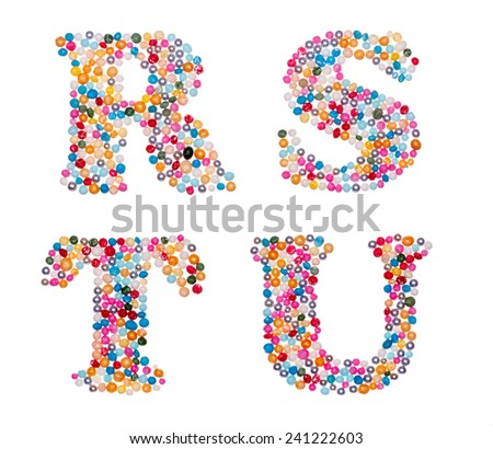 Letter set made of colorful sprinkles - capital letters R S T U