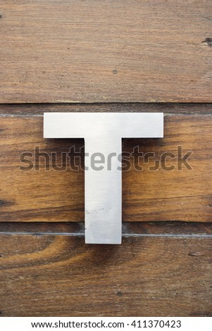 Letter T on wood