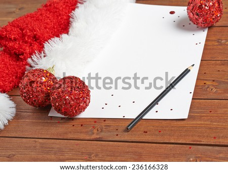 Letter to the Santa Claus composition of the copyspace blank sheet of paper next to multiple Christmas decorations over the wooden surface - stock photo