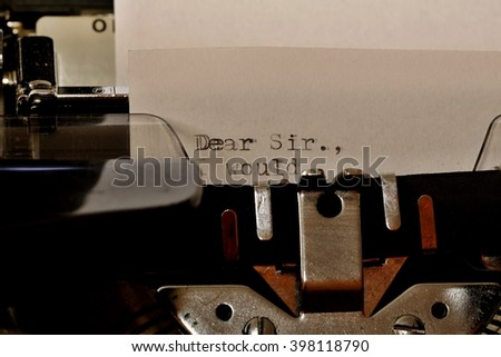 Letter with a title Dear Sir typed on old typewriter - stock photo