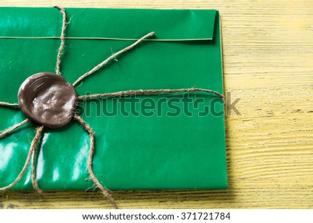 Letter with seal on table - stock photo