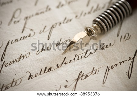 Letter written in beautiful English round calligraphy with metal nib pen. Brown ink on yellowish paper with visible grainy structure. - stock photo