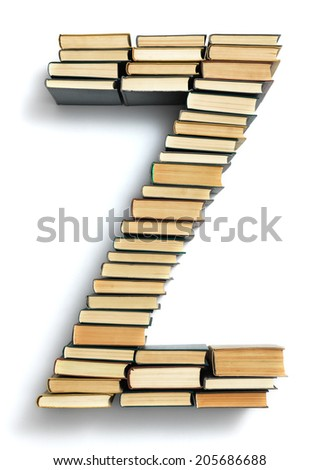 Letter Z formed from the page ends of closed vintage hardcover books standing on a white background from a set or series of numbers