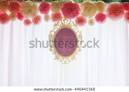 Lettering 'Forever in lover' hangs in a frame in the front of a window - stock photo