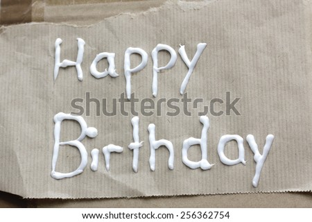 "lettering ""Happy Birthday"" on brown paper - stock photo"