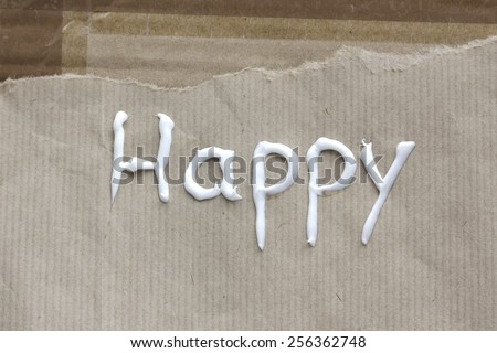 "lettering ""Happy "" on brown paper - stock photo"
