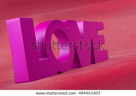 Lettering Love on pink background