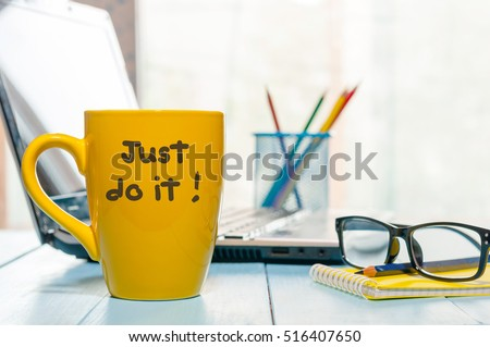 Lettering Of Inspirational Quote JUST DO IT On Yellow Morning Coffee Or  Other Hot Drink Cup