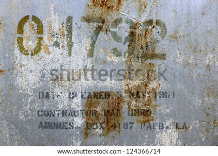 Lettering on an old derelict oil tank - stock photo