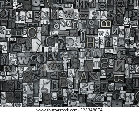 Letterpress background, close up of many old, random metal letters with copy space - stock photo
