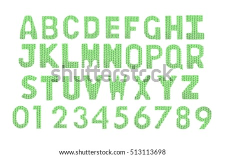 Letters and numerals english alphabet on a blurry texture knitted pattern of woolen thread closeup. Education and holidays. Typography design. Color green