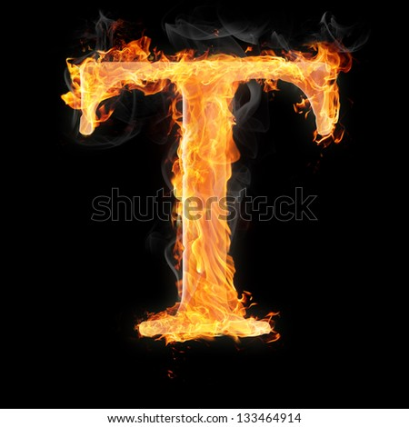 Letters and symbols in fire - Letter T. - stock photo