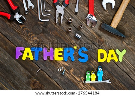 Letters and tools wooden background father's day - stock photo