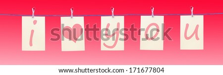 Letters hanging from a clothes line spelling I love you with a heart - stock photo