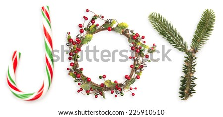 letters j-o-y / as portrayed by christmas things / candy cane and such - stock photo