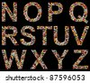 Letters N to Z on black, made of assorted, colorful pills - stock photo