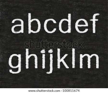 letters of English alphabet collection set, white and colors chalk writing on blackboard background - stock photo