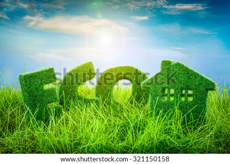 Letters on the and Little House green grass on blue background. Eco concept. - stock photo