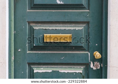 Letters slot at Old Wooden Door in Lisbon, Portugal. - stock photo