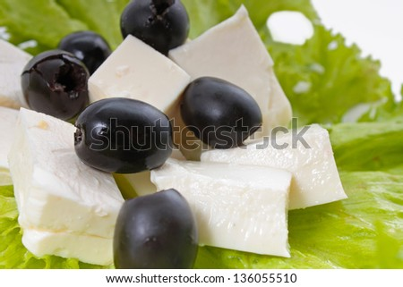 Lettuce and feta on the white background - stock photo