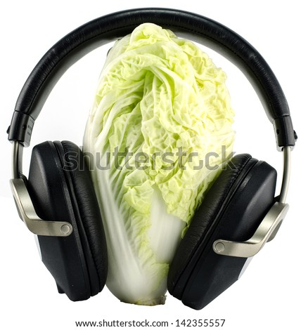lettuce and Headphones isolated on white background - music concept -