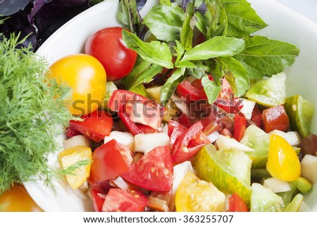 lettuce  with tomatoes and basil on the table