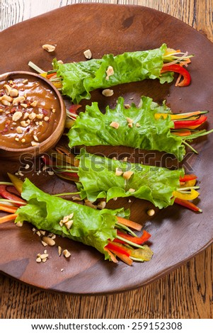 Lettuce wraps with  peanut dipping sauce - stock photo