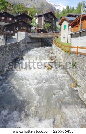 LEUKERBAD, SWITZERLAND - MAY 21, 2014: Water flowing in an artificial canal in Leukerbad, Switzerland.