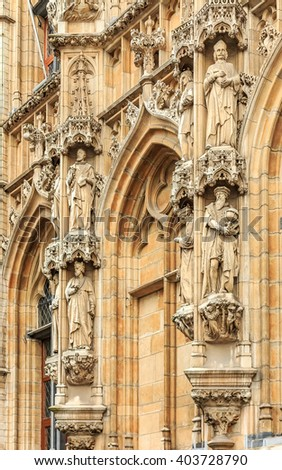 Leuven, Belgium - January 19, 2015: Facade of the gothic town hall on Grote Markt square