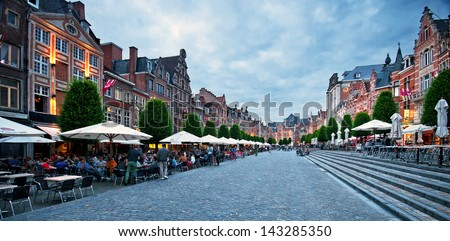 LEUVEN,BELGIUM - 21 JUNE, 2013: Row of beautiful buildings on Oude Markt (Old Square),  the longest bar in the world in Leuven, Belgium on 21 June 2013. - stock photo