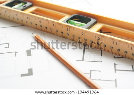 Level and pen on an architects plan  - stock photo