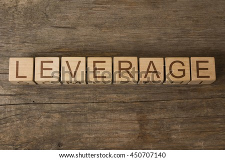 Leverage word on wooden cubes - stock photo