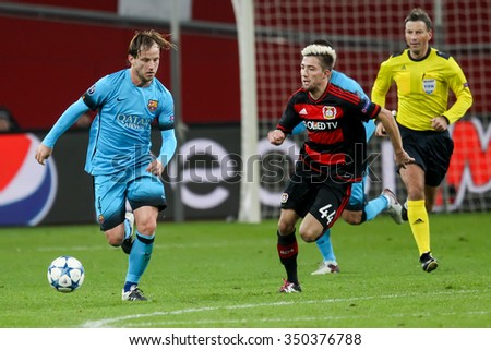 Leverkusen, Germany- December 9, 2015: Kevin Kampl (R) and Ivan Rakitic (L) during the UEFA Champions League game between Bayer 04 Leverkusen vs Barcelona at BayArena stadium