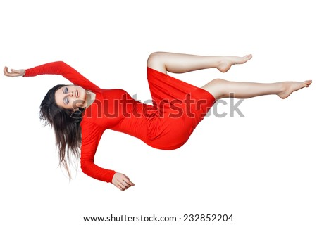 Levitates woman in a red dress, she spread her arms and legs, on white background. - stock photo
