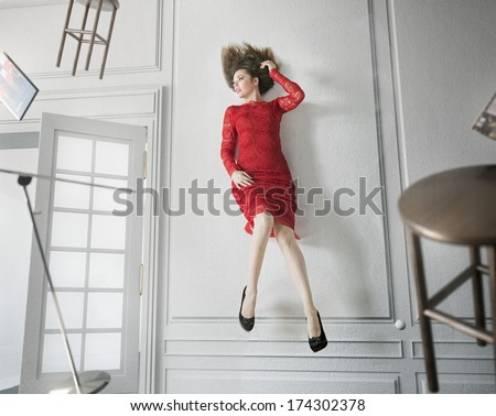 Levitating brunette beauty - stock photo