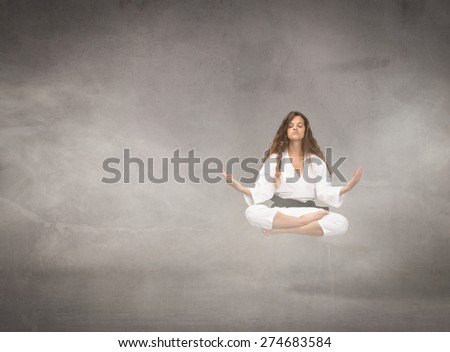 levitation for an oriental warrior, cloudy room - stock photo
