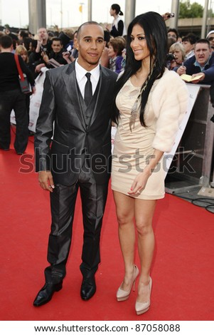 Lewis Hamilton and Nicole Scherzinger arriving for the National Movie Awards 2011, at Wembley Arena, London. 11/05/2011  Picture By: Steve Vas / Featureflash