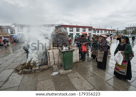 LHASA - FEBRUARY 11: Tibetan people make offerings during Losar Festival on February 11, 2013 in Lhasa, Tibet. Losar is Tibetan New Year and the most important festival in Tibet.