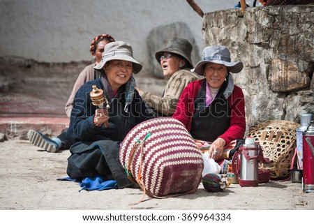LHASA - JUNE 5: Unidentified Tibetan pilgrim rests during the Jokhang temple pilgrimage on June 5, 2013 in Lhasa, Tibet. The Jokhang temple is the holiest temple for Tibetan people. - stock photo