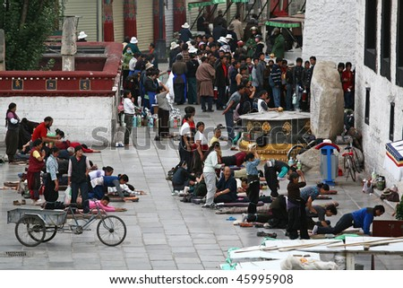 LHASA - SEPTEMBER 8: Tibetan worshippers from all over Tibet pray in front of their holiest temple, the Jokhang on September 8, 2009 in Lhasa