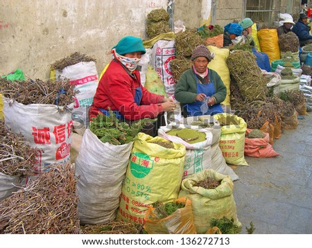 LHASA, TIBET-NOVEMBER 17: woman selling herbs in Barkhor Street area. The ancient street is a symbol of Lhasa and a must see place for visitors. November 17, 2004 in Lhasa, Tibet