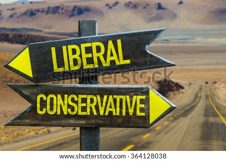Liberal - Conservative signpost in a desert road on background - stock photo