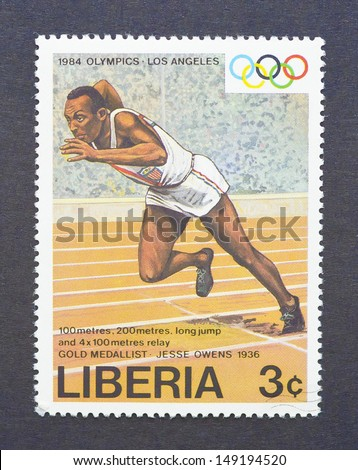 LIBERIA - CIRCA 1984: a postage stamp printed in Liberia showing an image of the olympic athlete gold medal winner Jesse Owens, circa 1984.  - stock photo