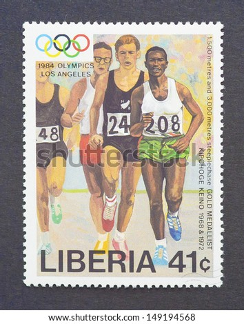 LIBERIA - CIRCA 1984: a postage stamp printed in Liberia showing an image of the olympic athlete gold medal winner Kipchoge Keino, circa 1984.  - stock photo