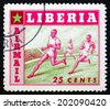 LIBERIA - CIRCA 1955: a stamp printed in the Liberia shows Running, Sport, circa 1955 - stock photo