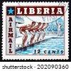 LIBERIA - CIRCA 1955: a stamp printed in the Liberia shows Swimming, Sport, circa 1955 - stock photo
