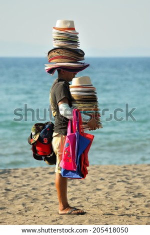 LIBERIA-MARCH 18: Nicaraguan vendor sells hats on March 18 in Liberia, Costa Rica. Every year about 2 million Nicaraguans immigrate as seasonal workers in Costa Rica. - stock photo