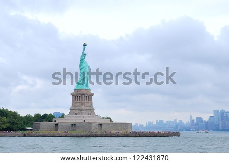 Liberty Island and Statue of Liberty, view from the water. - stock photo